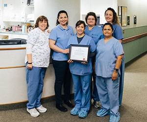 Good Shepherd Health Care System Family Birth Center Staff proudly display their National Safe Sleep Hospital Certification.